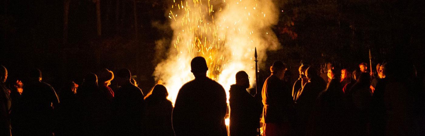 group around bonfire